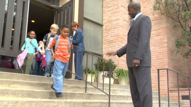 MS, Teachers saying good bye to children (6-7, 8-9) leaving school