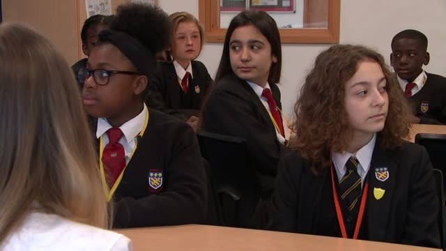 teachers working with police and youth charities to reduce knife crime; uk, hertfordshire, cheshunt, st mary's high school; various students entering... - head teacher stock videos & royalty-free footage
