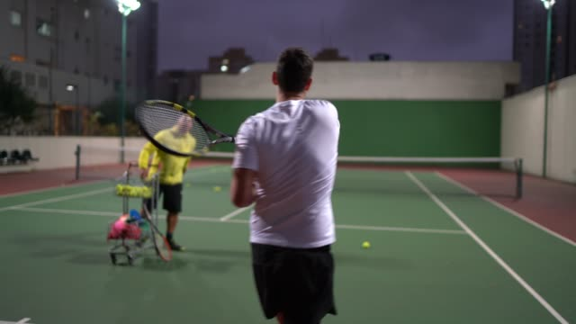 teaching a guy how to play tennis - tennis stock videos & royalty-free footage