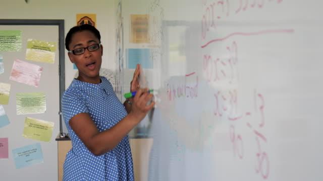teaching a mathematics lesson - mathematics stock videos & royalty-free footage