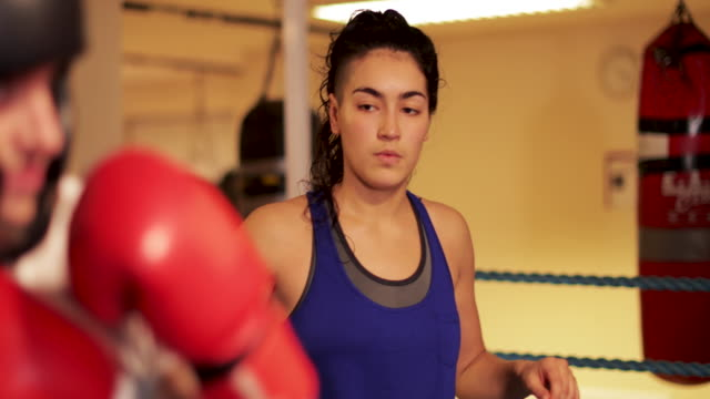 teaching correct form in boxing - female with group of males stock videos and b-roll footage