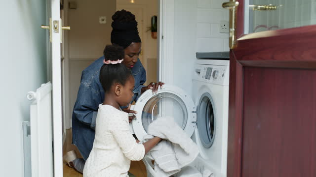 teaching her household basics - washing stock videos & royalty-free footage