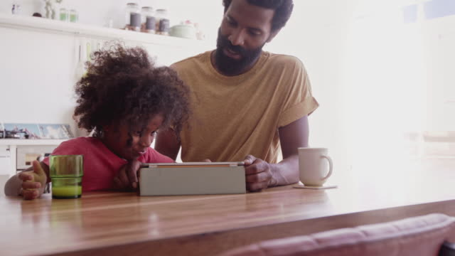 Teaching his son technology