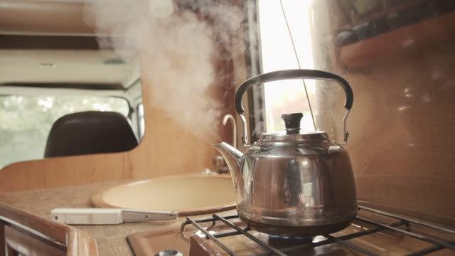 teakettle on burner in camper van - absence stock videos & royalty-free footage