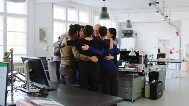 team building workshop in office - arm around stock videos & royalty-free footage