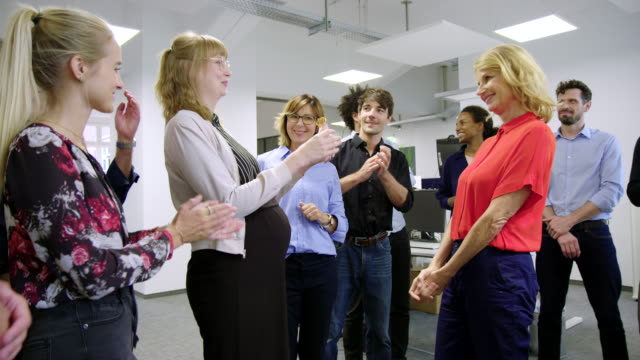 team congratulating pregnant colleague with a gift - award stock videos & royalty-free footage
