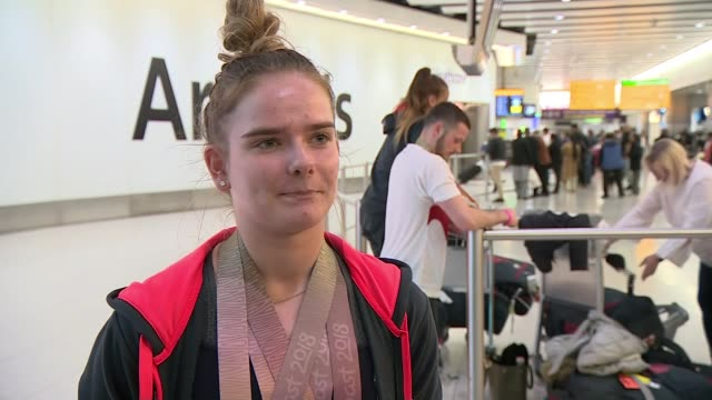 Team England athletes return to UK ENGLAND London Heathrow Airport Alice Kinsella interview SOT