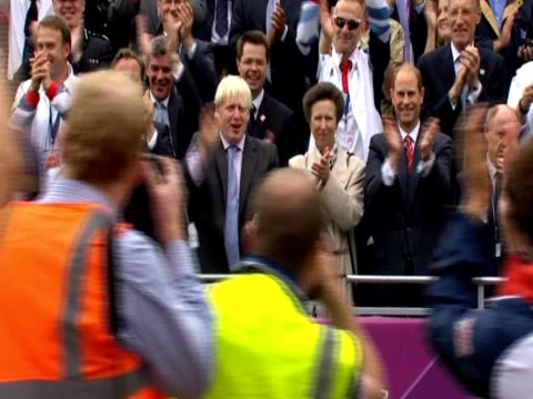 Team GB athletes wave at UK Prime Minister David Cameron London's Mayor Boris Johnson and Princess Anne from bus during the celebration parade