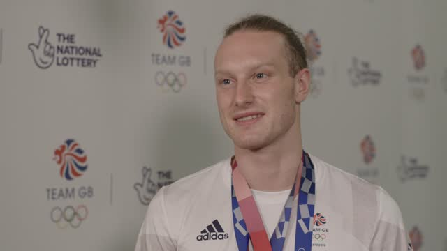 team gb swimmer and olympian luke greenbank talks about quarantining before the olympics and celebrating on their return to the uk. the gb swimming... - gold coloured stock videos & royalty-free footage
