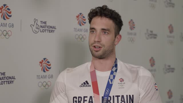 team gb swimmer and olympic champion calum jarvis talks about taking extended time off after his olympics win. the gb swimming team had their best... - gold coloured stock videos & royalty-free footage