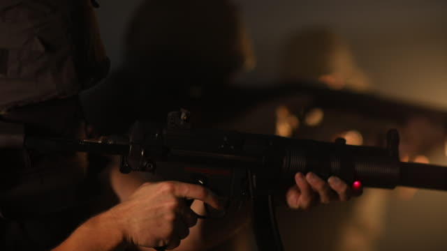 swat team guy aiming with machine gun - stealth stock videos & royalty-free footage