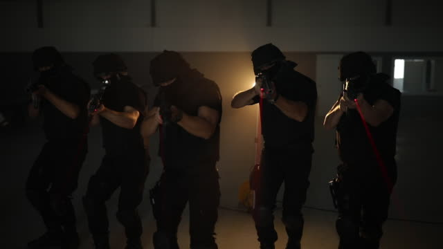 swat team guy aiming with machine gun - machine gun stock videos & royalty-free footage