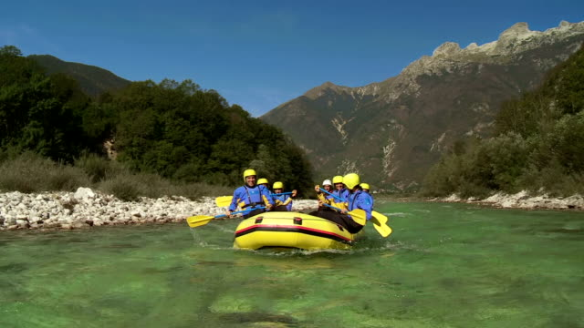 hd: team having fun rafting - rafting stock videos and b-roll footage