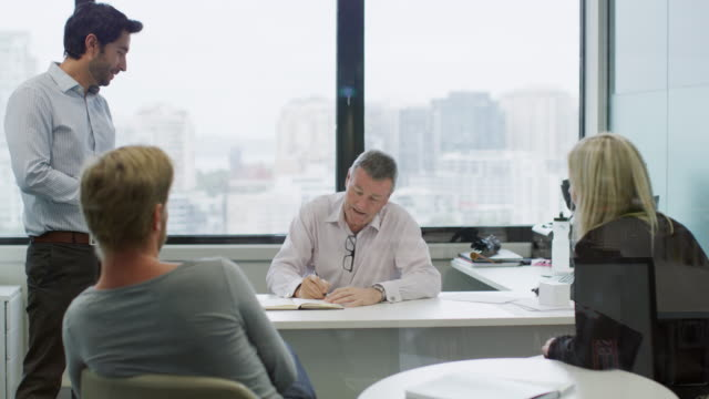 WS A team in discussion during a project meeting