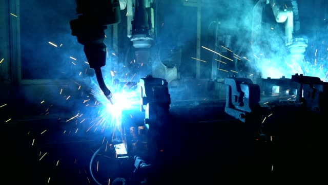 team industrial robot are welding automotive part - automatic stock videos & royalty-free footage