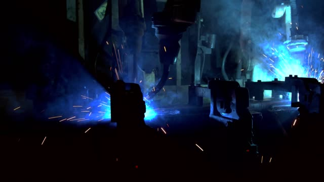 team industrial robots are welding in factory - welding stock videos & royalty-free footage