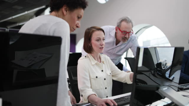 Team looking at computer in an office