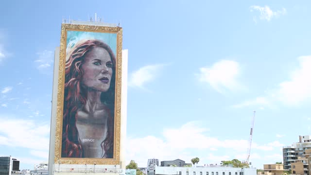 AUS: Team Of Artists Hand Paint Giant 18-Story Portrait Nicole Kidman On Building In Sydney