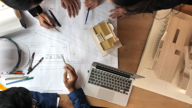 slo mo team of architects brainstorming the design solutions - conference table stock videos & royalty-free footage