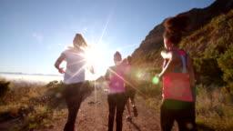 Team of athletes running outdoors on summer