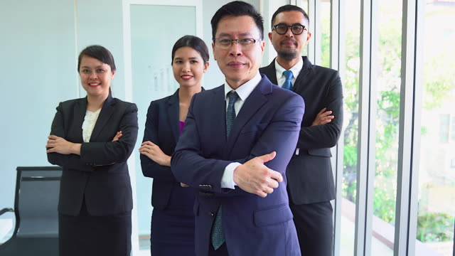 team of business men and women standing in a crossed-arms folded position, 4 people can be used in teamwork content. or a successful team - thumbs up stock videos & royalty-free footage