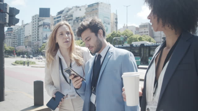 team of business people is waiting to cross the street in the city - avenida 9 de julio video stock e b–roll