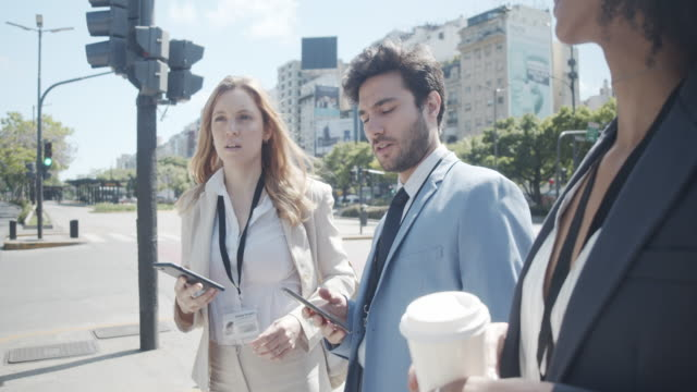 team of business people is waiting to cross the street in the city - avenida 9 de julio stock videos & royalty-free footage