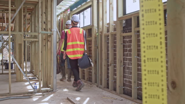 team of construction arriving at construction site - construction worker stock videos & royalty-free footage