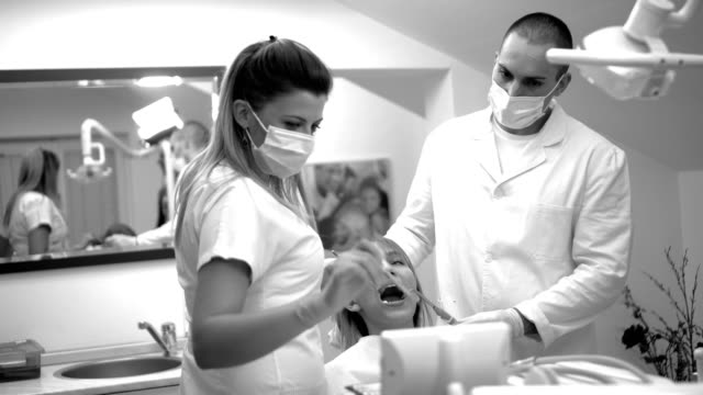team of dentists examines the teeth of the patient - plaque bacteria stock videos & royalty-free footage