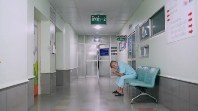 team of doctors and nurses walking through hospital. - operating stock videos & royalty-free footage