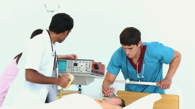 MS Team of doctors rescuing patient (8-9) using defibrillator / Cape Town, South Africa