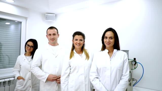 team of doctors - laboratory coat stock videos & royalty-free footage