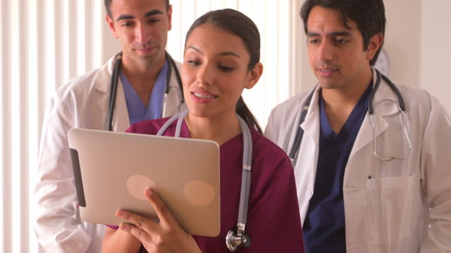 team of doctors working on a tablet - puerto rican ethnicity stock videos & royalty-free footage