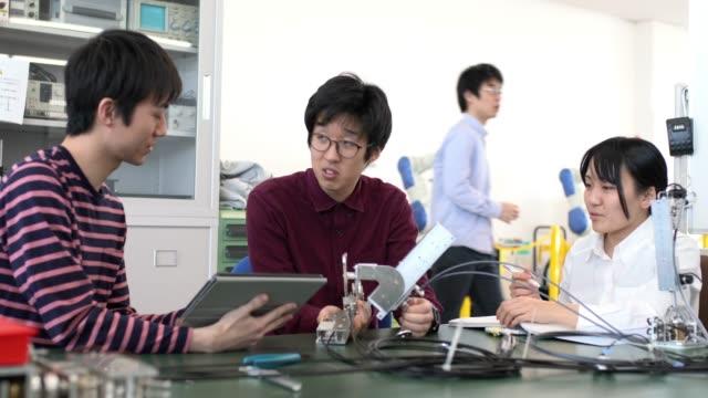 team of engineering students working - stem stock videos & royalty-free footage