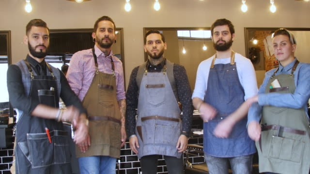 team of hairstylists with arms crossed at salon - colleague stock videos & royalty-free footage