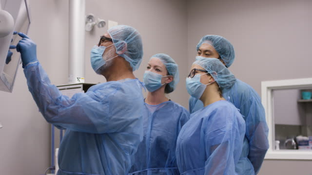 team of healthcare professionals ready for surgery. - fatcamera stock videos & royalty-free footage