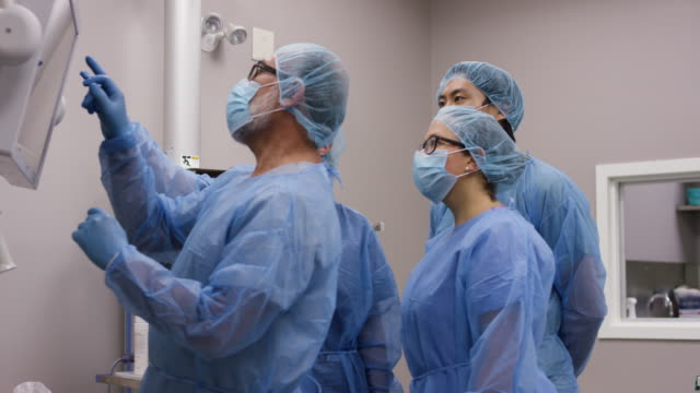 team of healthcare professionals ready for surgery. - canada stock videos & royalty-free footage