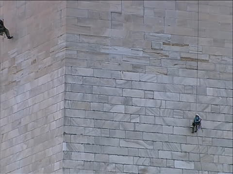 monument a team of inspectors rappel down the washington monument to look for damage caused by the august 2011 northeast earthquake engineers began... - august stock videos & royalty-free footage