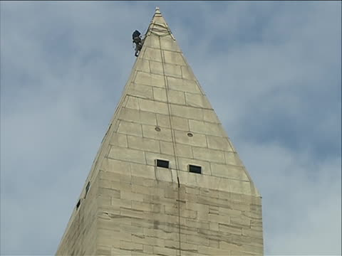 a team of inspectors rappel down the washington monument to look for damage caused by the august 2011 northeast earthquake engineers began inspecting... - august stock videos & royalty-free footage