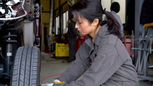Team of mechanics working in a car garage