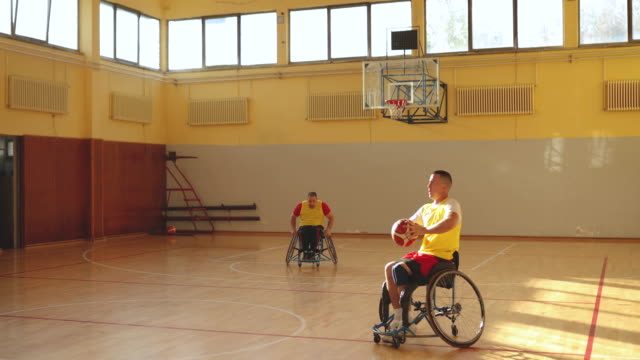team of men in wheelchair playing basketball - basketball player stock videos & royalty-free footage
