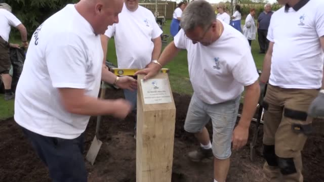 a team of national lottery winners complete a new walkway construction project at the national memorial arboretum in staffordshire after two days of... - lottery stock videos and b-roll footage