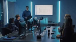 Team of Professional IT Developers Have a Meeting, Speaker Talks about New Blockchain Based Software Development Shown on TV. Concept: Software Development, Deep Learning, Artificial Intelligence, Data Mining