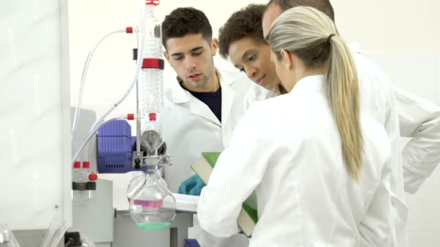 team of scientists in a laboratory - scrubs stock videos & royalty-free footage