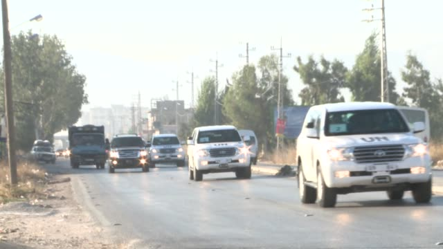 A team of UN inspectors crosseS into Lebanon from Syria after completing their probe into a suspected chemical weapons attack near Damascus CLEAN UN...