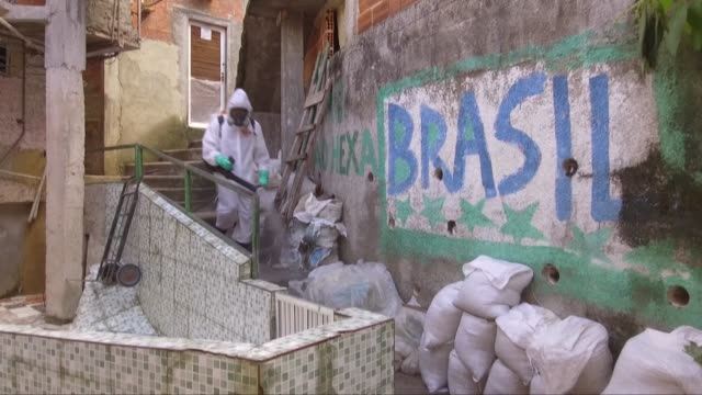 a team of volunteers sprays disinfectants in rio de janeiro's favelas to stop the spread of covid19 saying that the government is not serving these... - spraying stock videos & royalty-free footage