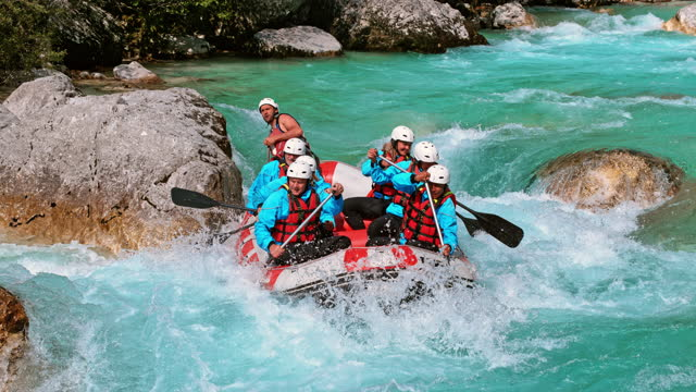 slo mo ld team of white water rafters rowing across the rapids - rapid stock videos & royalty-free footage