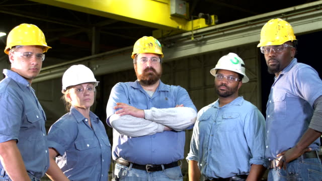 team of workers with hard hats, safety glasses, serious - manufacturing occupation stock videos & royalty-free footage