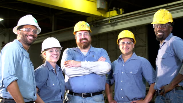 team of workers with hard hats, safety glasses, smiling - people in a line stock videos & royalty-free footage