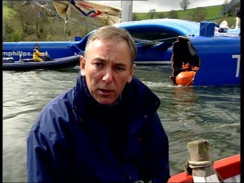 team philips catamaran arrives at home port; itn england: devon: totnes: int gvs bow in workshop damage to bow seen thru plastic sheeting ext i/c... - b rolle stock-videos und b-roll-filmmaterial